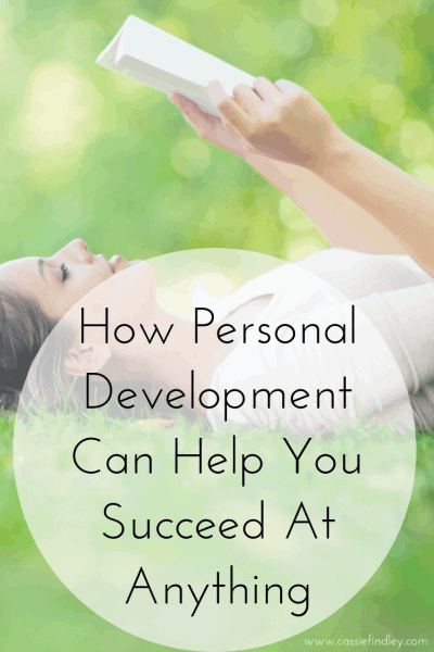 Picture of woman laying on grass reading a book with text overlay that says: how personal development can help you succeed at anything!