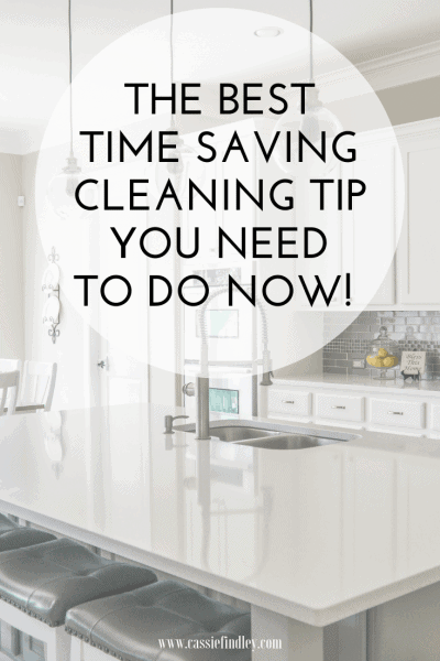 Picture of a clean, white kitchen with text overlay that says: The Best Time Saving Cleaning Tip You Need To Do NOW!