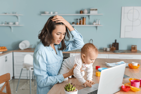 Overwhelmed mom working with kid